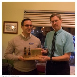 Josh Cash, KE8EAS, is presented with the NC8V Memorial Trophy by Eric McFadden, WD8RIF