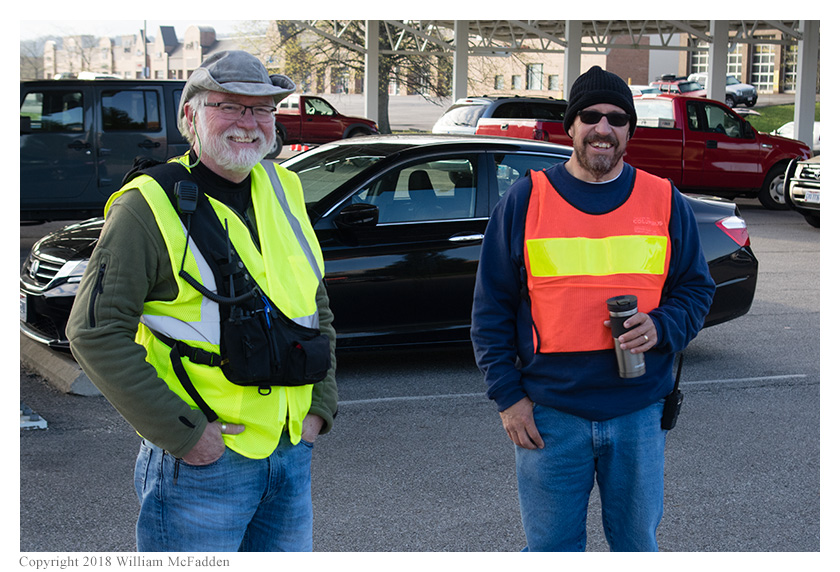 Mike Cooper, KC8WMY, (left) working parking and Rob Rose, KE8JDA, (right) working the tailgate area